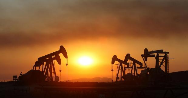 100550500-oil-rigs-smoke-sunset-california-getty.1910x1000